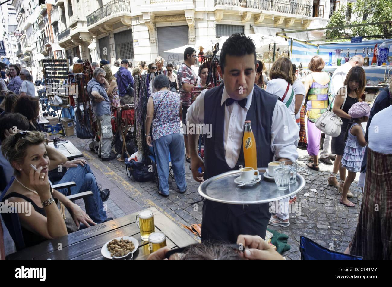 Waiter with tray, Bar, Plaza Dorrego, San Telmo, Buenos Aires, Argentina - Stock Image