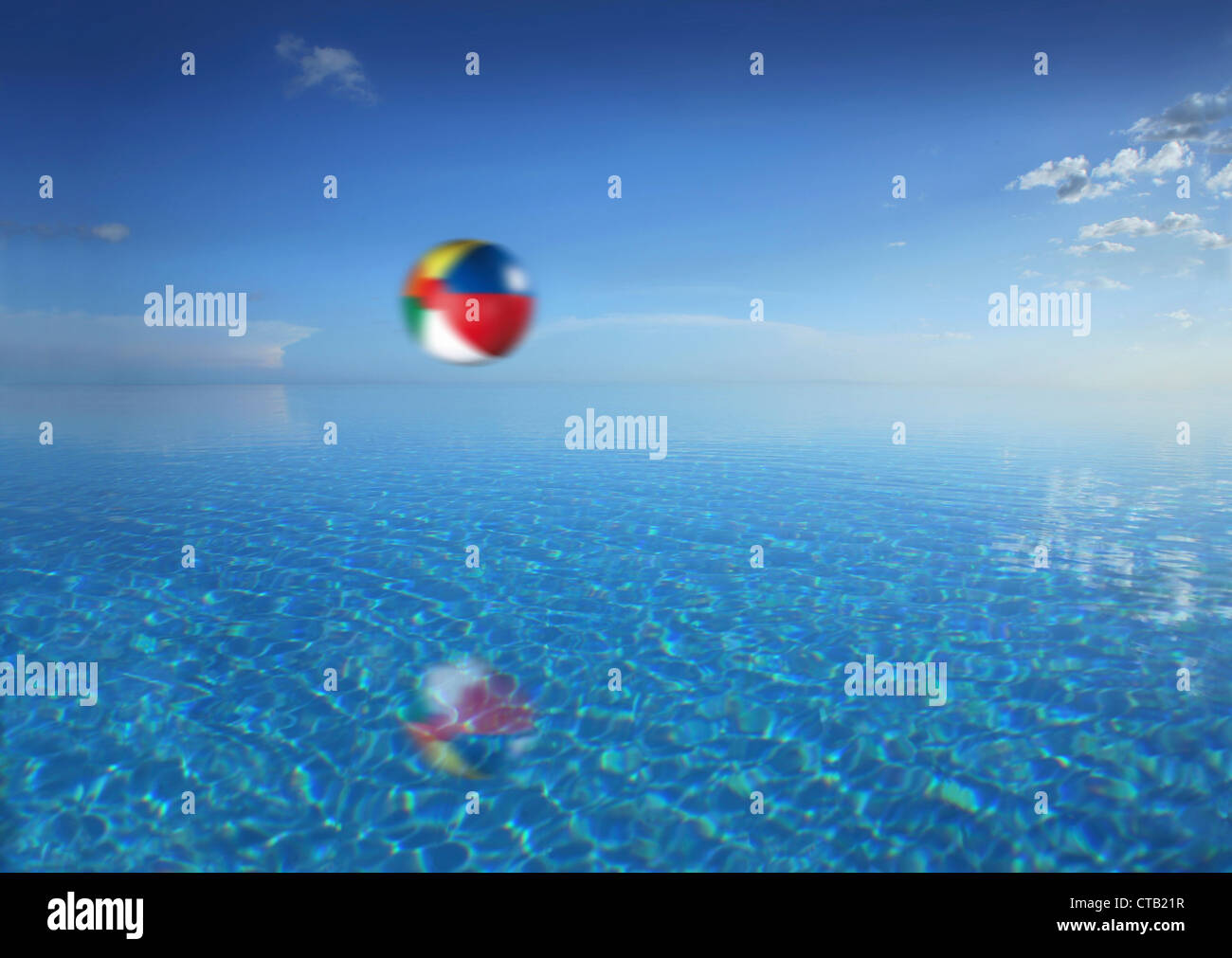 Beachball flying over an infinity pool, Bohol island, Visayas, Philippines - Stock Image