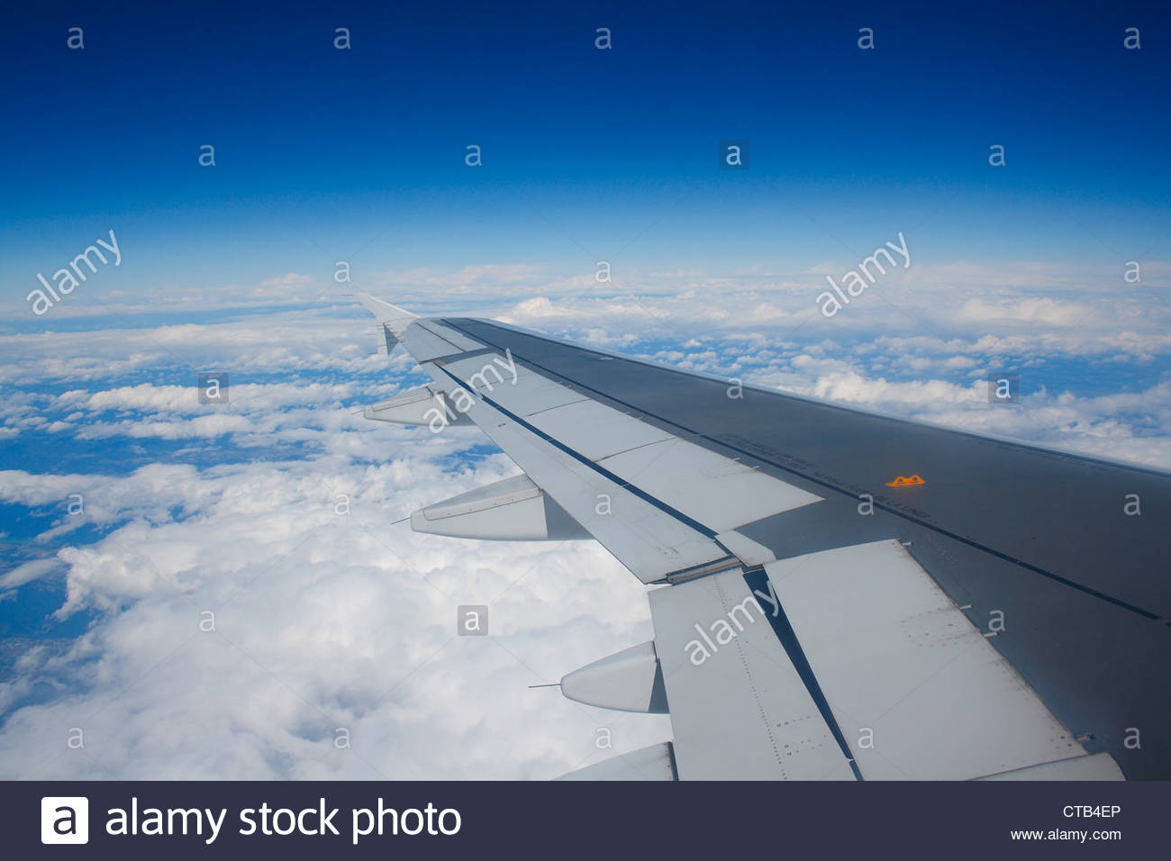 Airplane wing, flying over france. - Stock Image