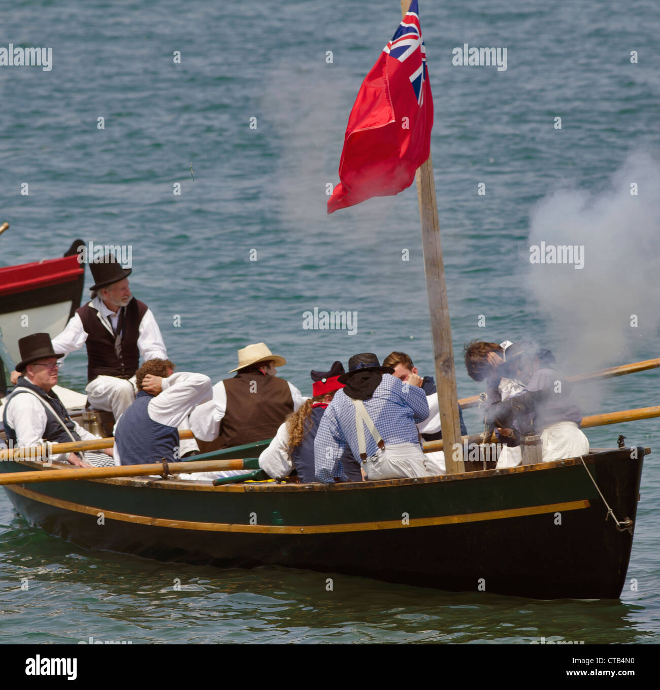 British Sailor re enactors fire their cannon in support of the beach assault. Stock Photo