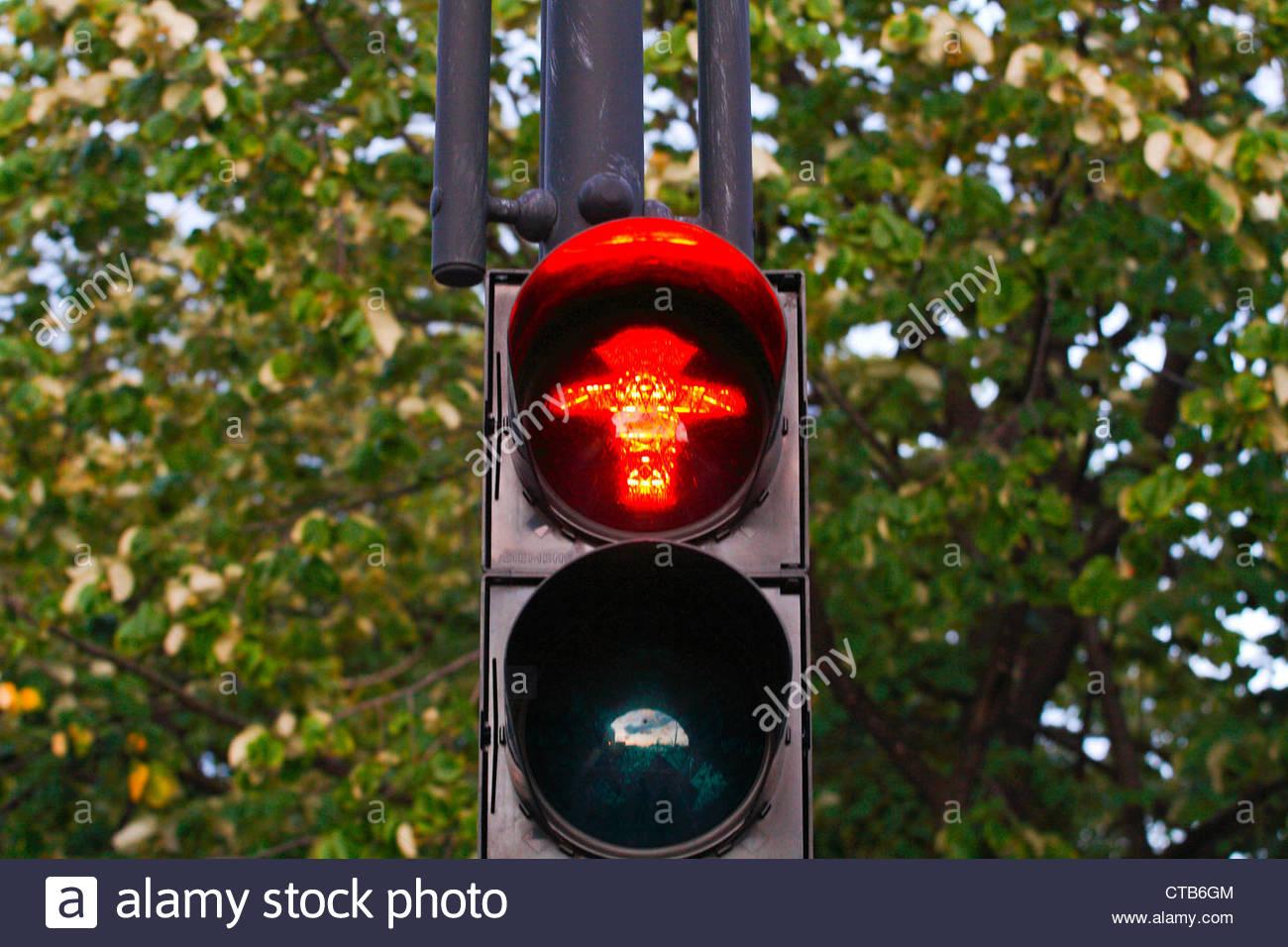 Ampelmännchen, typical traffic light in East Berlin.Pedestrian red light. - Stock Image