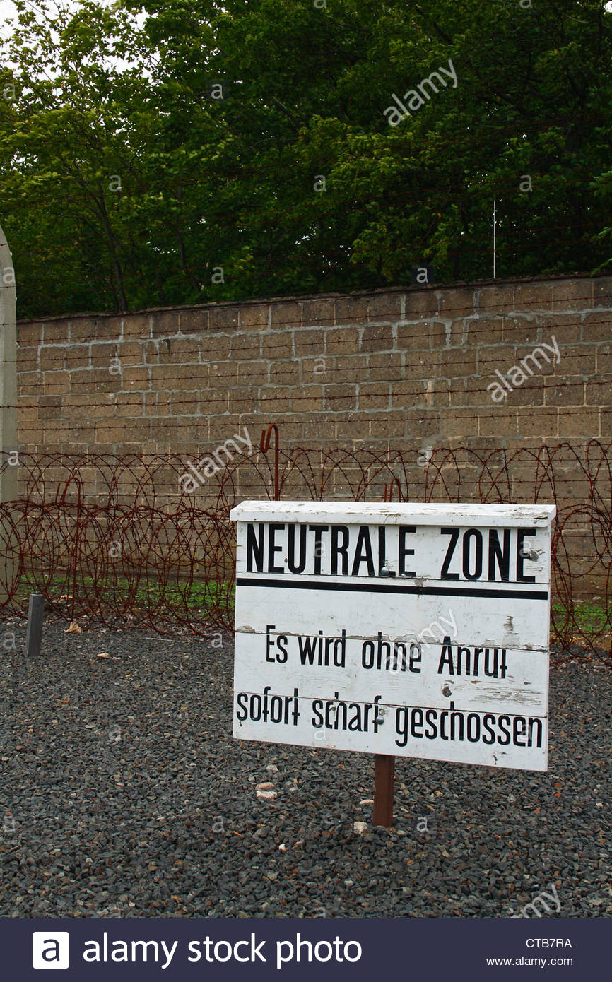Wire fence and sign in Sachsenhausen concentration camp, in Oranienburg, Germany. - Stock Image