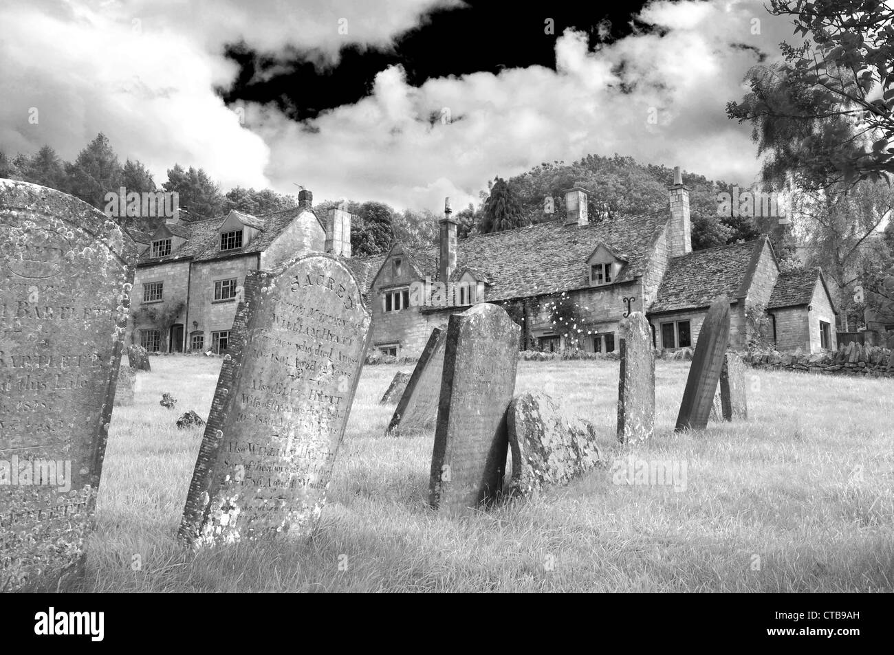 St. Barnabas Churchyard in black and white,Snowshill, the Cotswolds, Gloucestershire, England UK - Stock Image