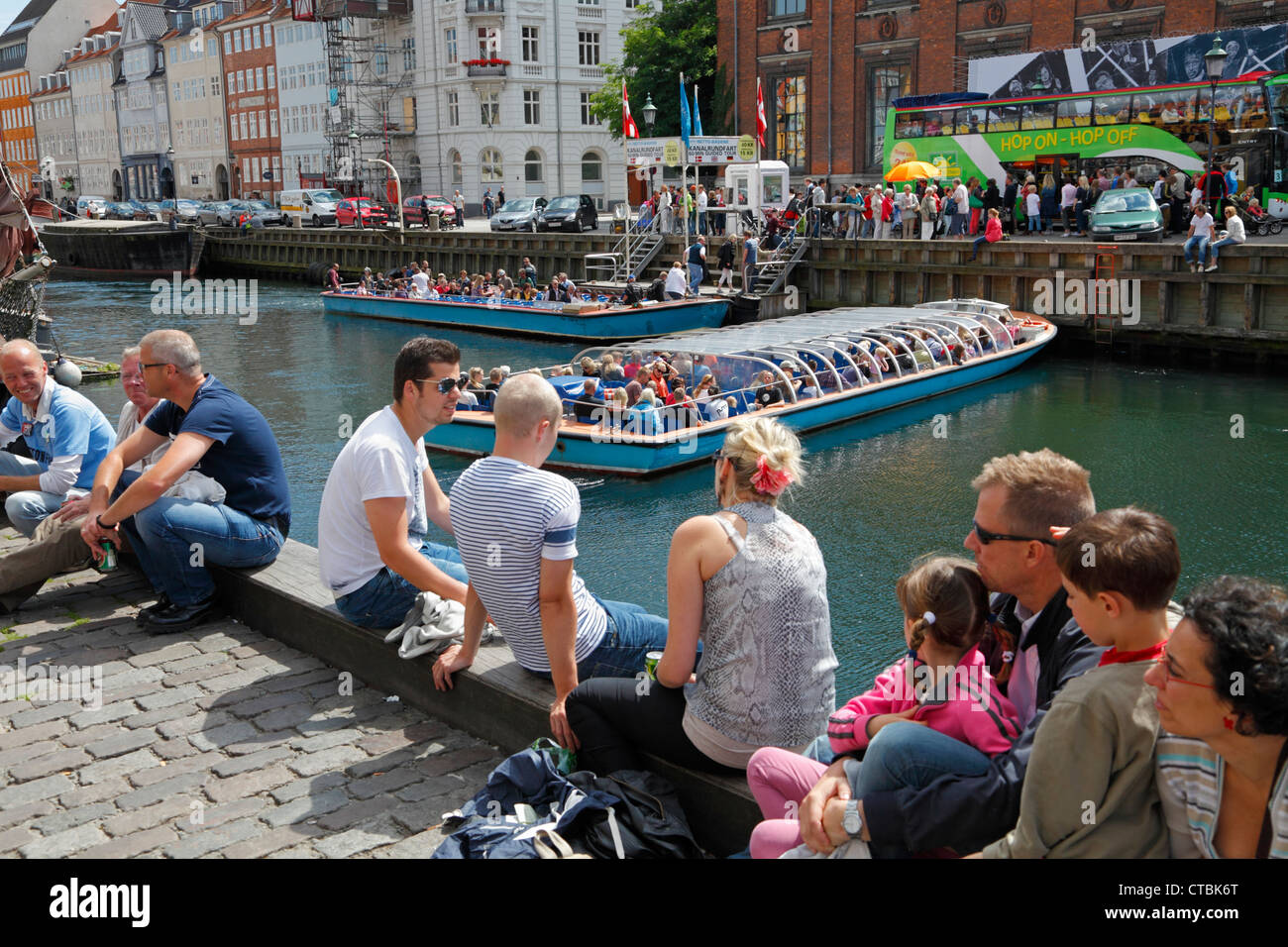 Nyhavn quay crowded with tourists and jazz fans on a sunny summer day during the Copenhagen Jazz Festival. Copenhagen, Stock Photo