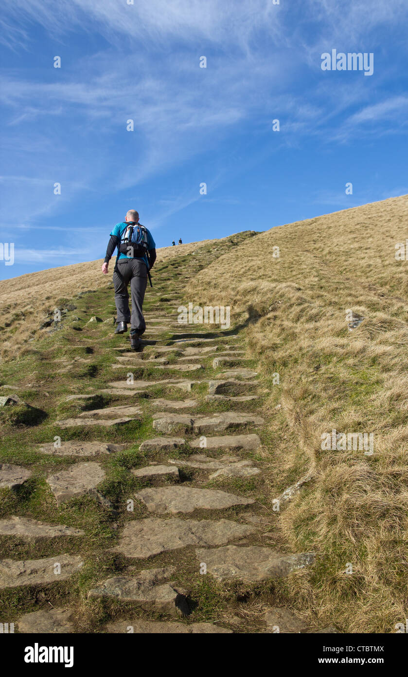 Man hiking up Lose Hill, Peak District National Park, UK - Stock Image