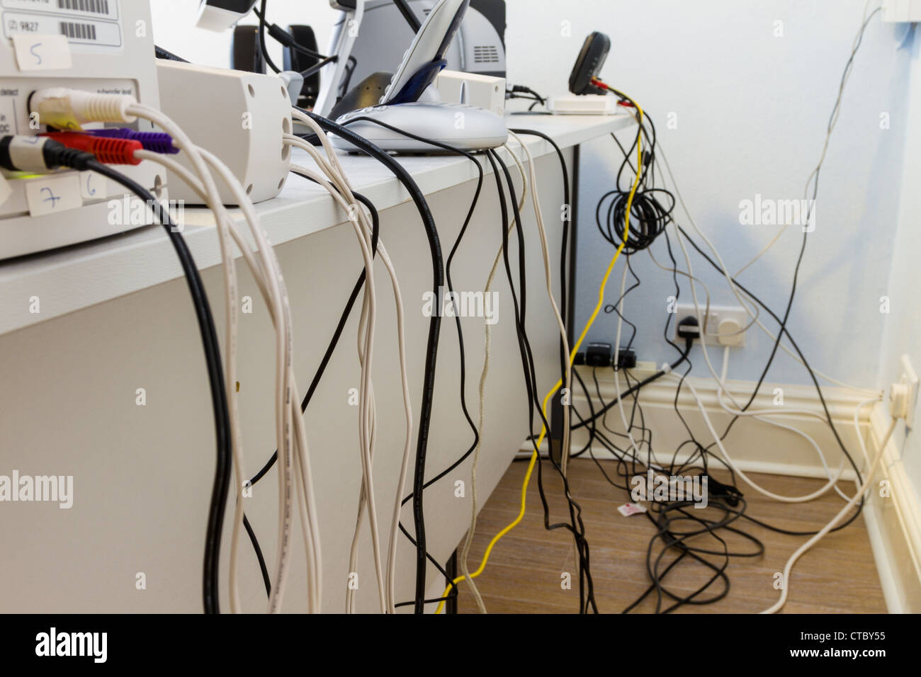 untidy office cables and wires - stock image