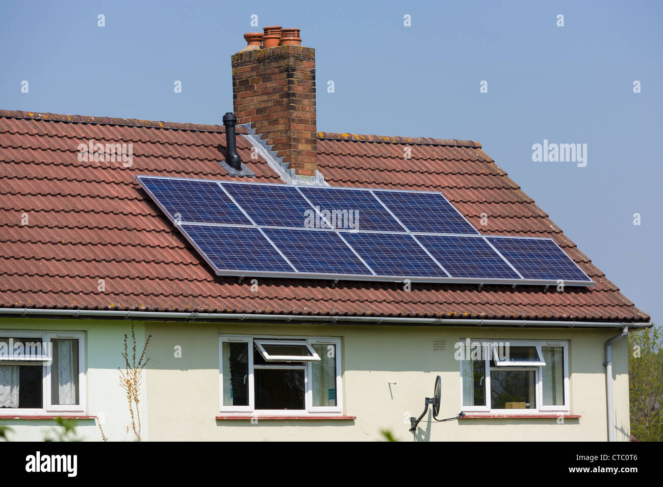 Solar panels, on council house roof - Stock Image