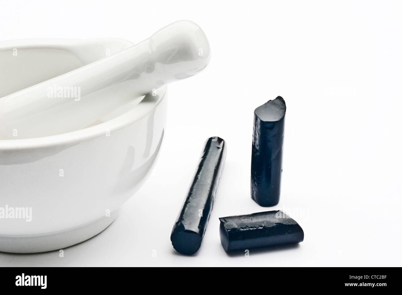 liquorice sticks with mortar - Stock Image