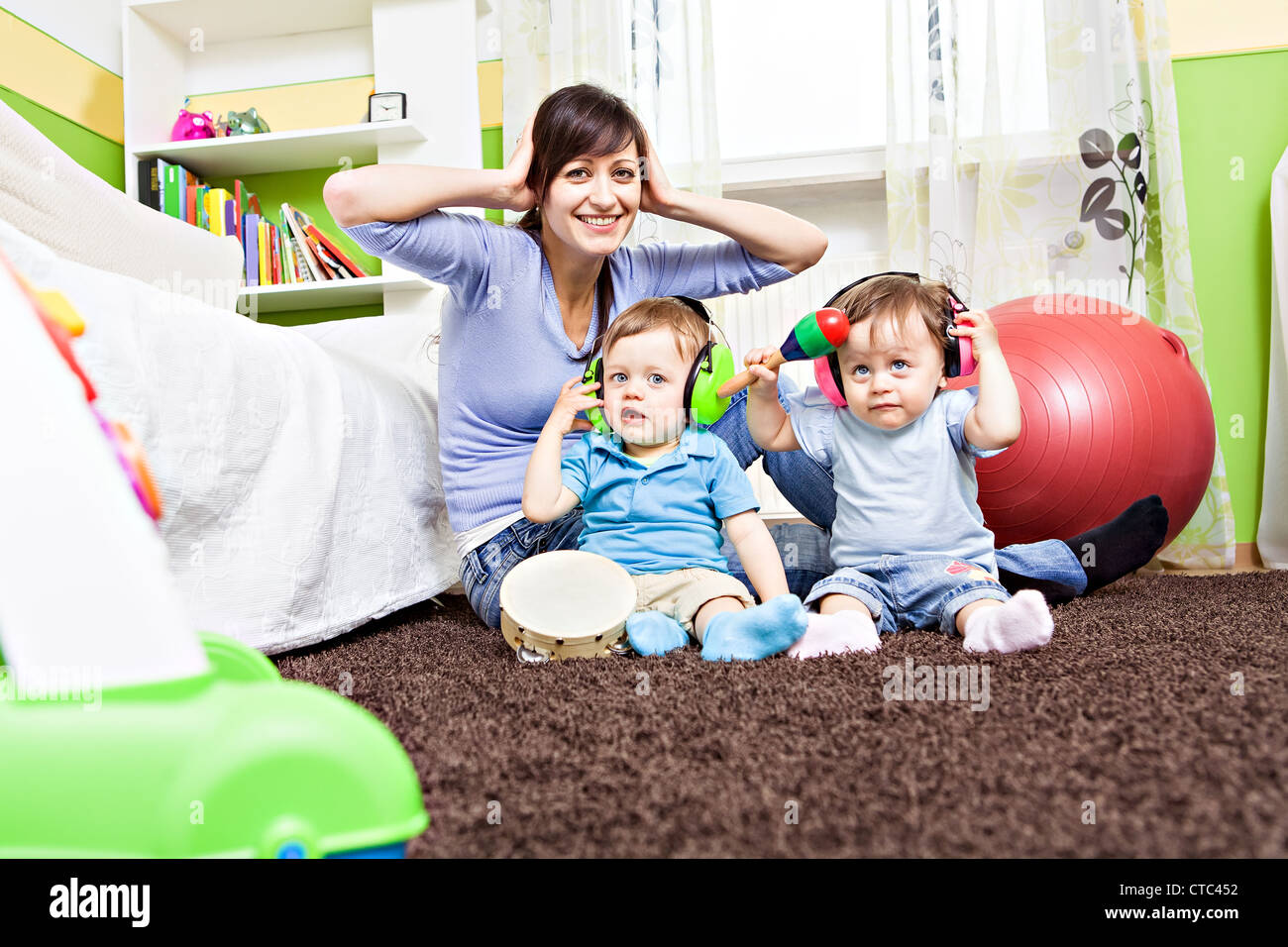little toddler twins playing in the child's room Stock Photo