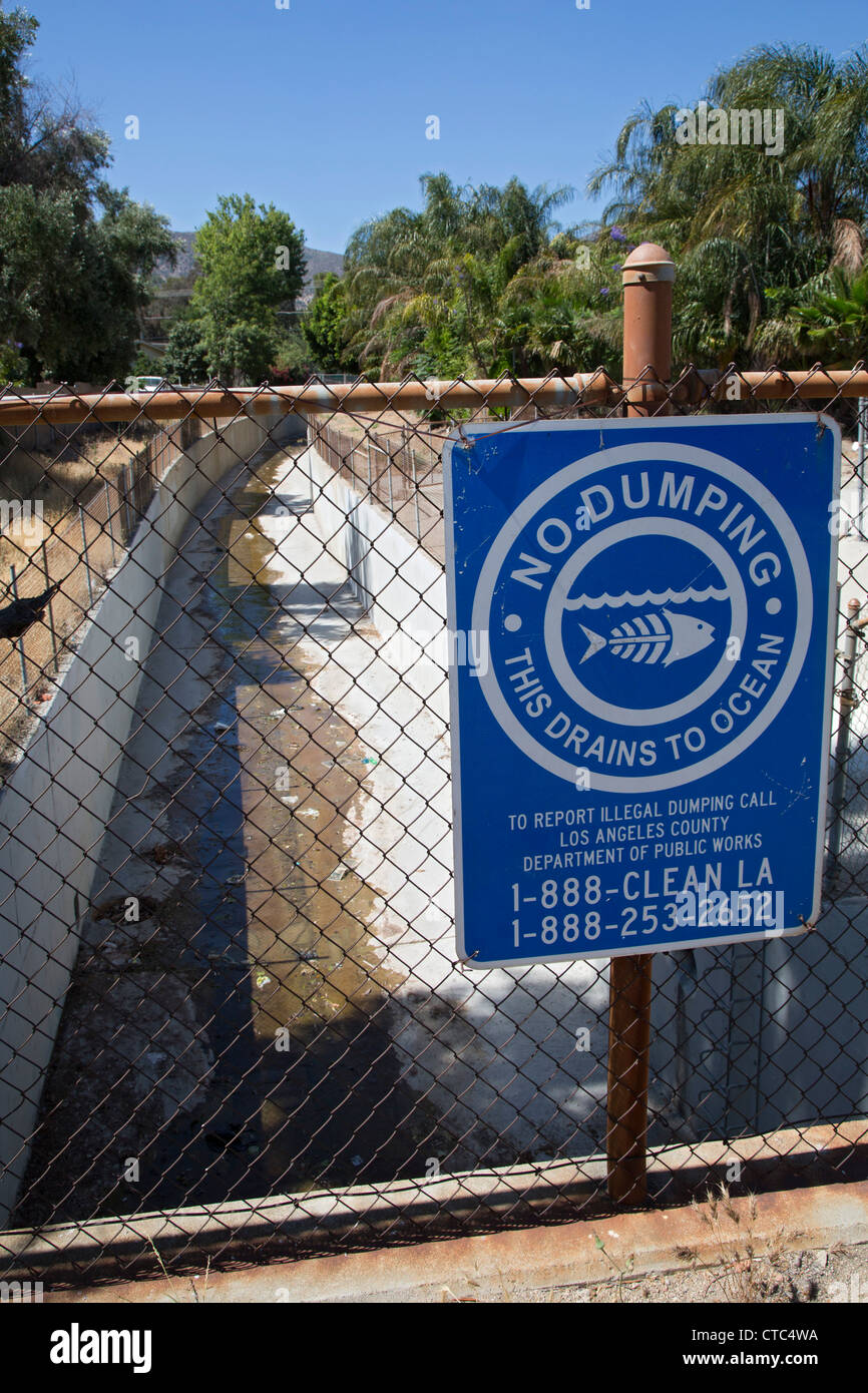 Sylmar, California - A sign warns against illegal dumping in a canal that drains storm water to the Pacific Ocean. - Stock Image