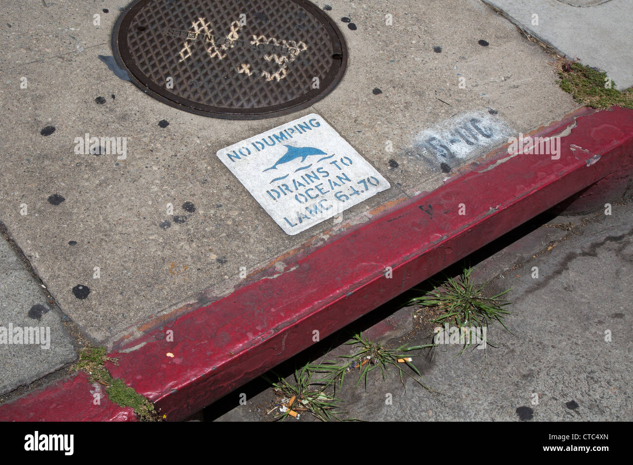 Los Angeles, California - A sign warns against illegal dumping in a storm water drain that leads to the Pacific - Stock Image