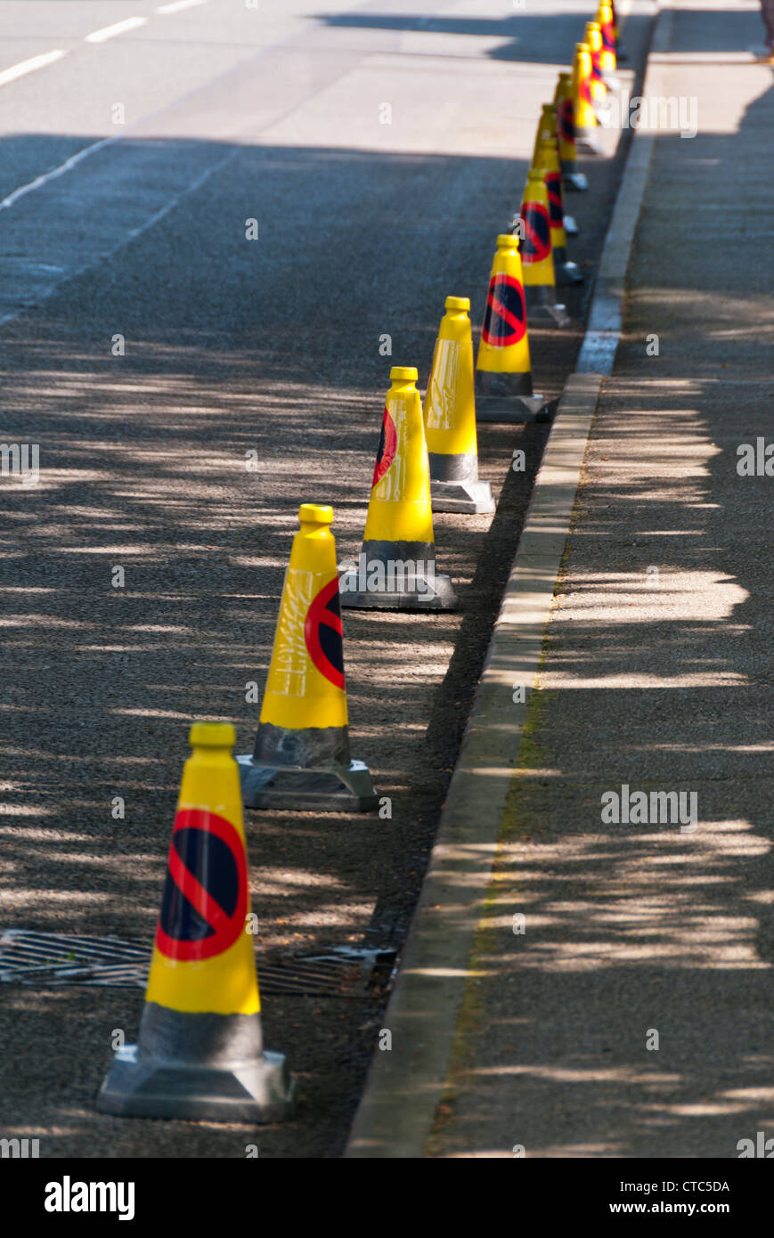 Traffic cones placed along the Olympic Torch route, Painswick, Gloucestershire, UK - Stock Image