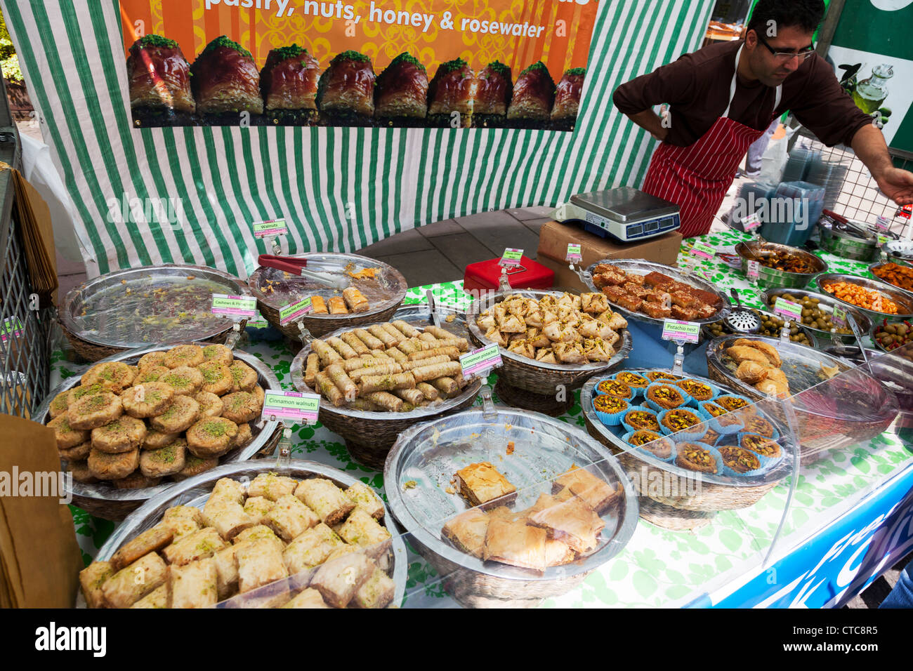 Market stall holder selling Turkish Baklava  at Louth food festival Lincolnshire, UK, England - Stock Image
