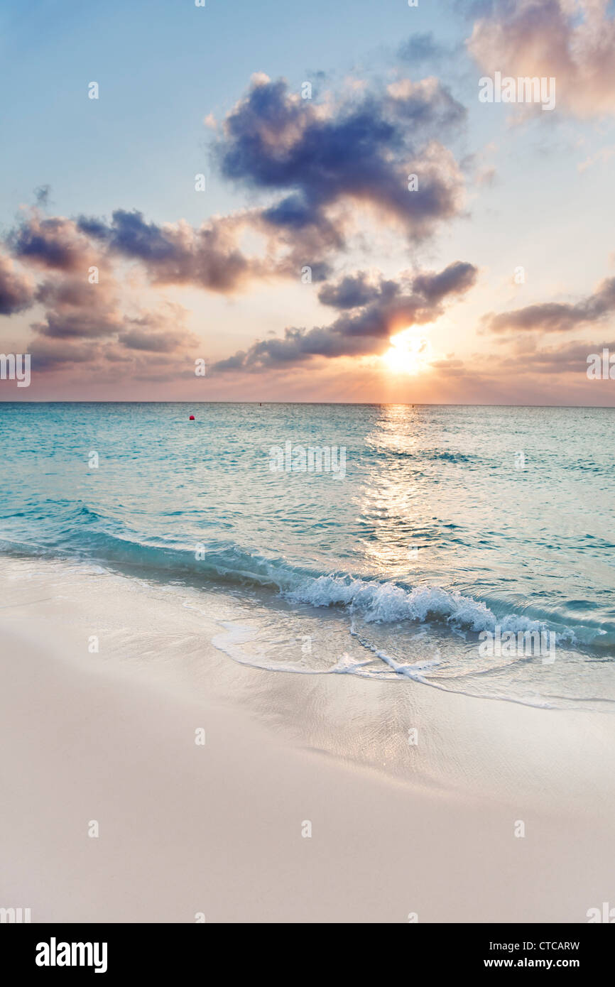 Sun about to set over Seven Mile Beach, Grand Cayman - Stock Image
