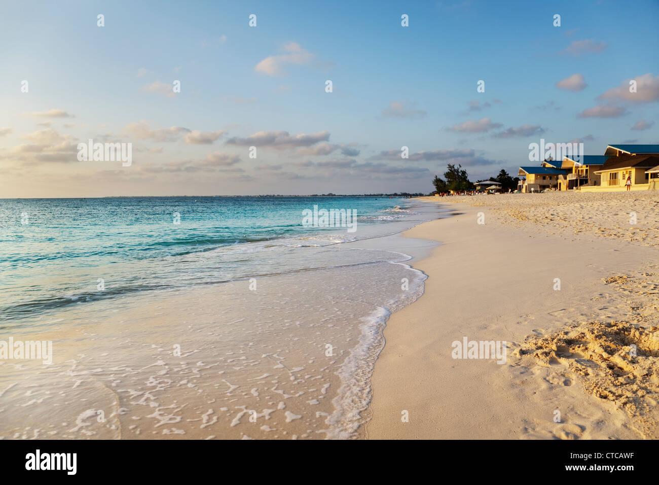Sunset light warms Seven Mile Beach, Grand Cayman - Stock Image