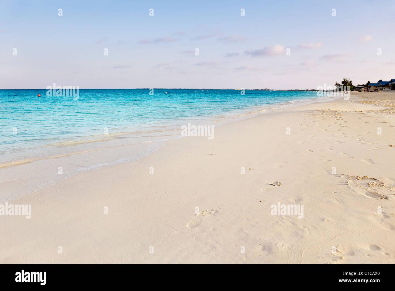 Sunrise creeps over Seven Mile Beach, Grand Cayman - Stock Image