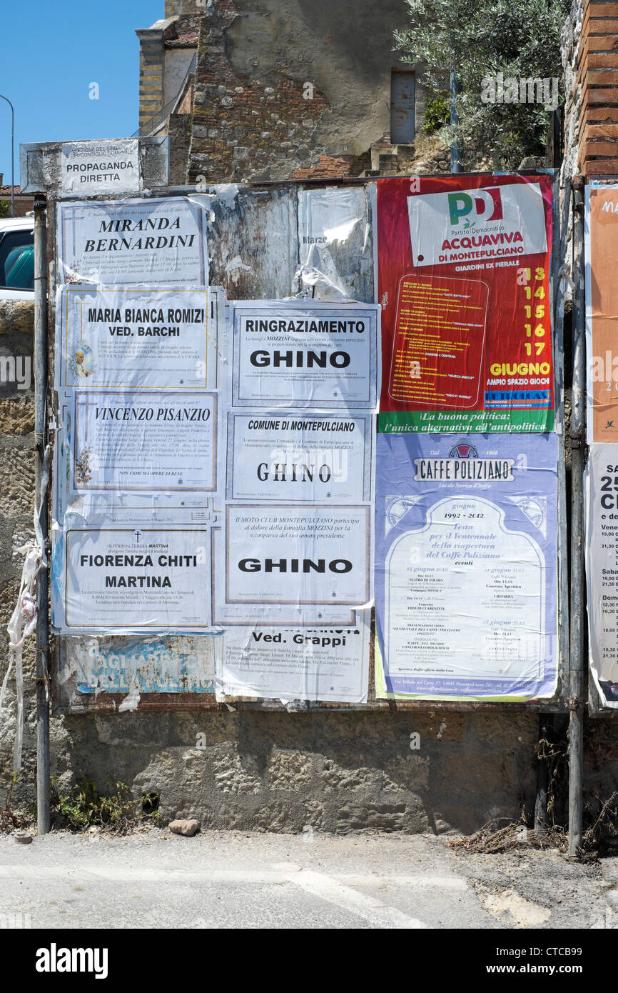 Italian posters and notices on notice board - Stock Image