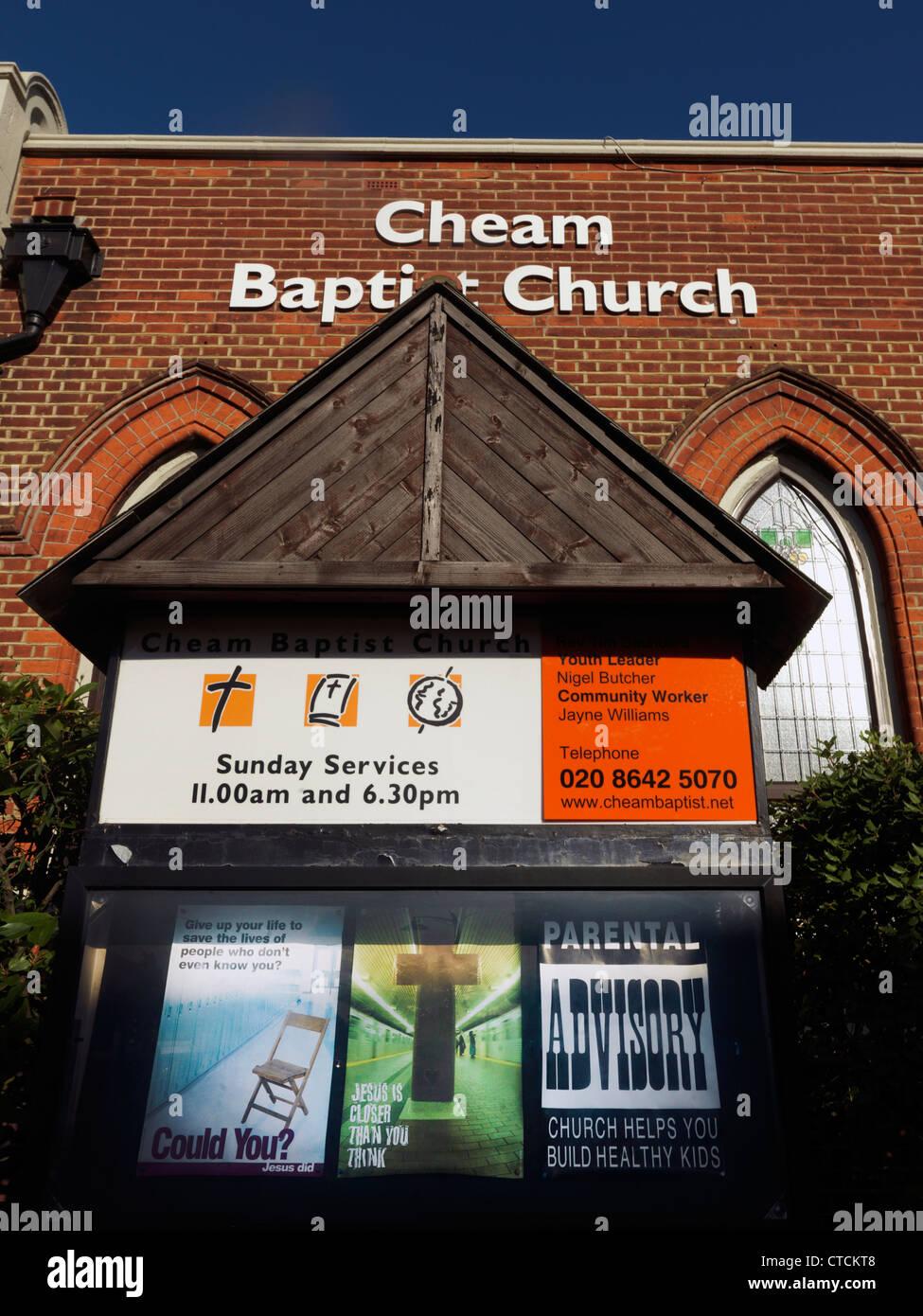 Church Noticeboard Outside Cheam Baptist Church Surrey England - Stock Image