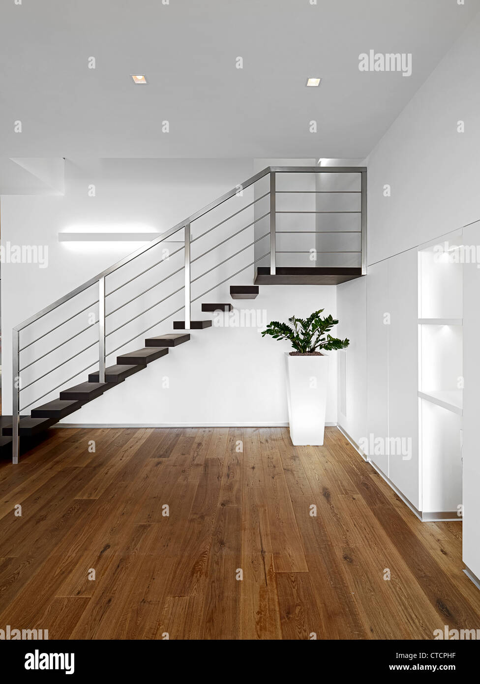 modern entrance with staircase  and wood floor - Stock Image