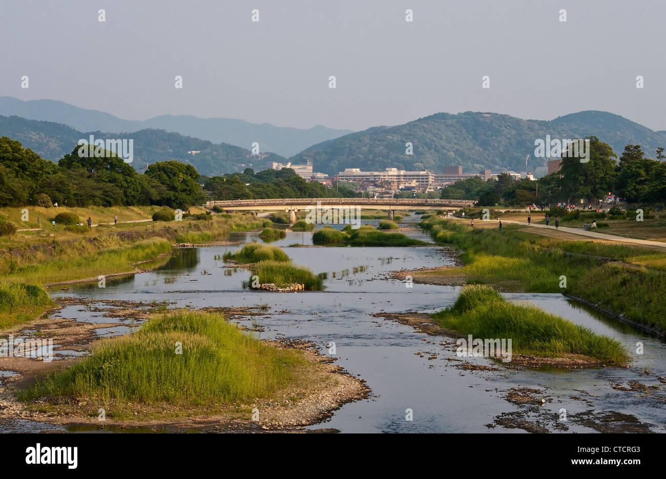 Kyoto, Japan. Looking south along the peaceful Kamo River (Kamogawa River) towards the city centre Stock Photo