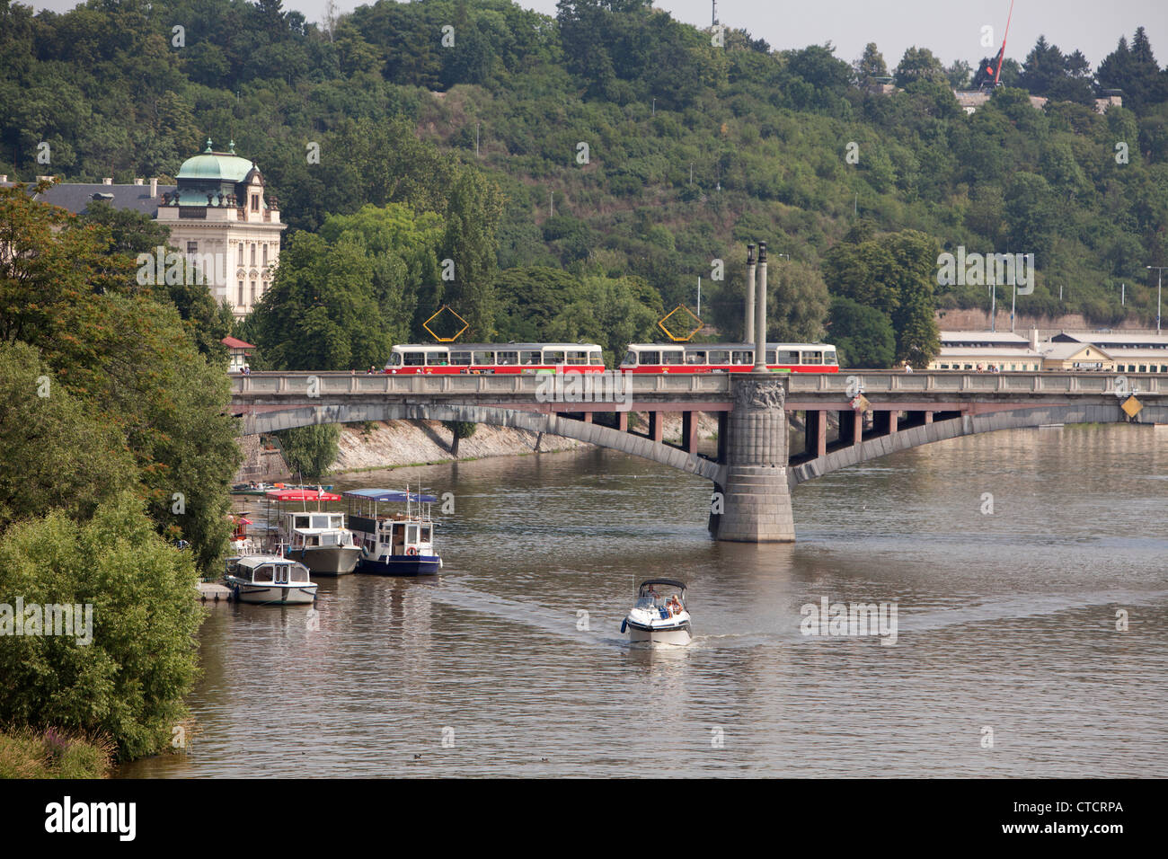 Prague Praga Czech republic tranway rail train river briged Moldava urban transport viajeros voyager modern city - Stock Image