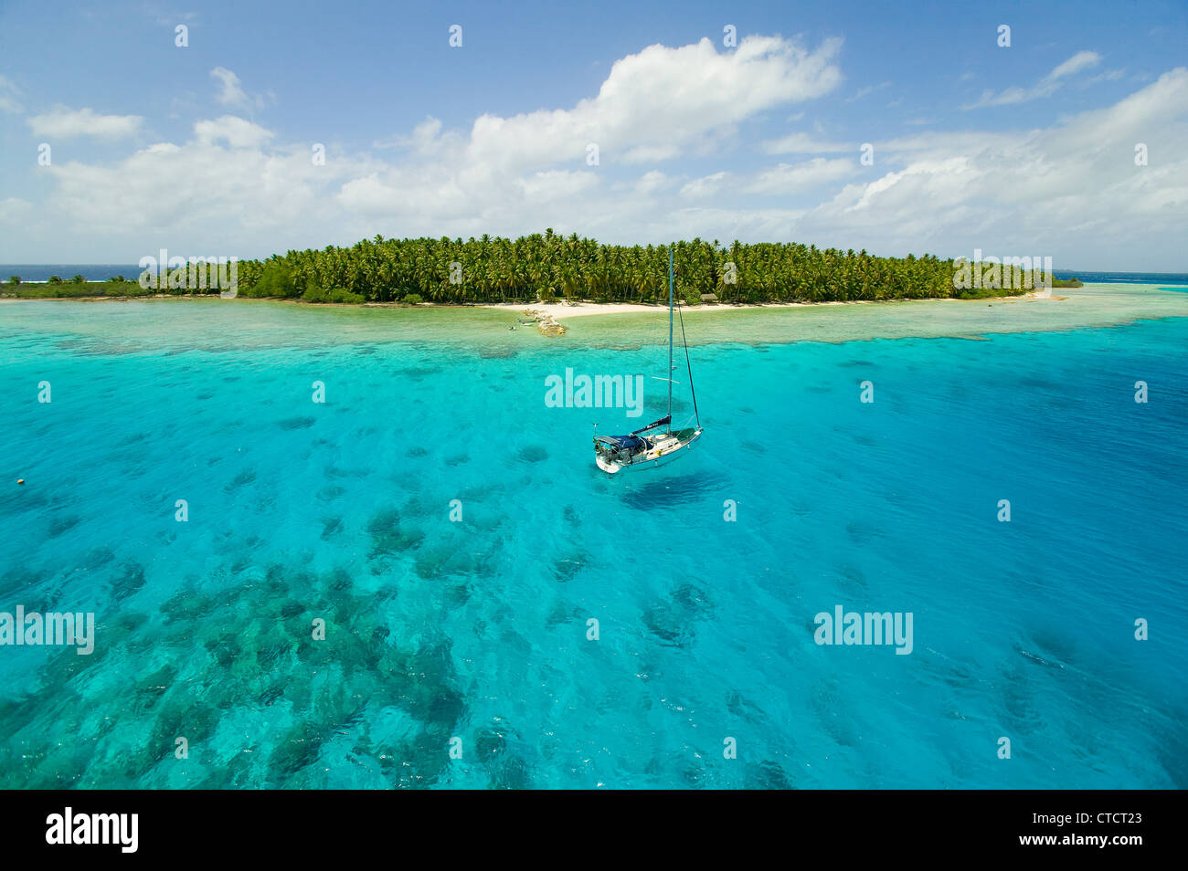 sailing vessel on the anchorage of Suwarrow atoll, Cook Islands - Stock Image