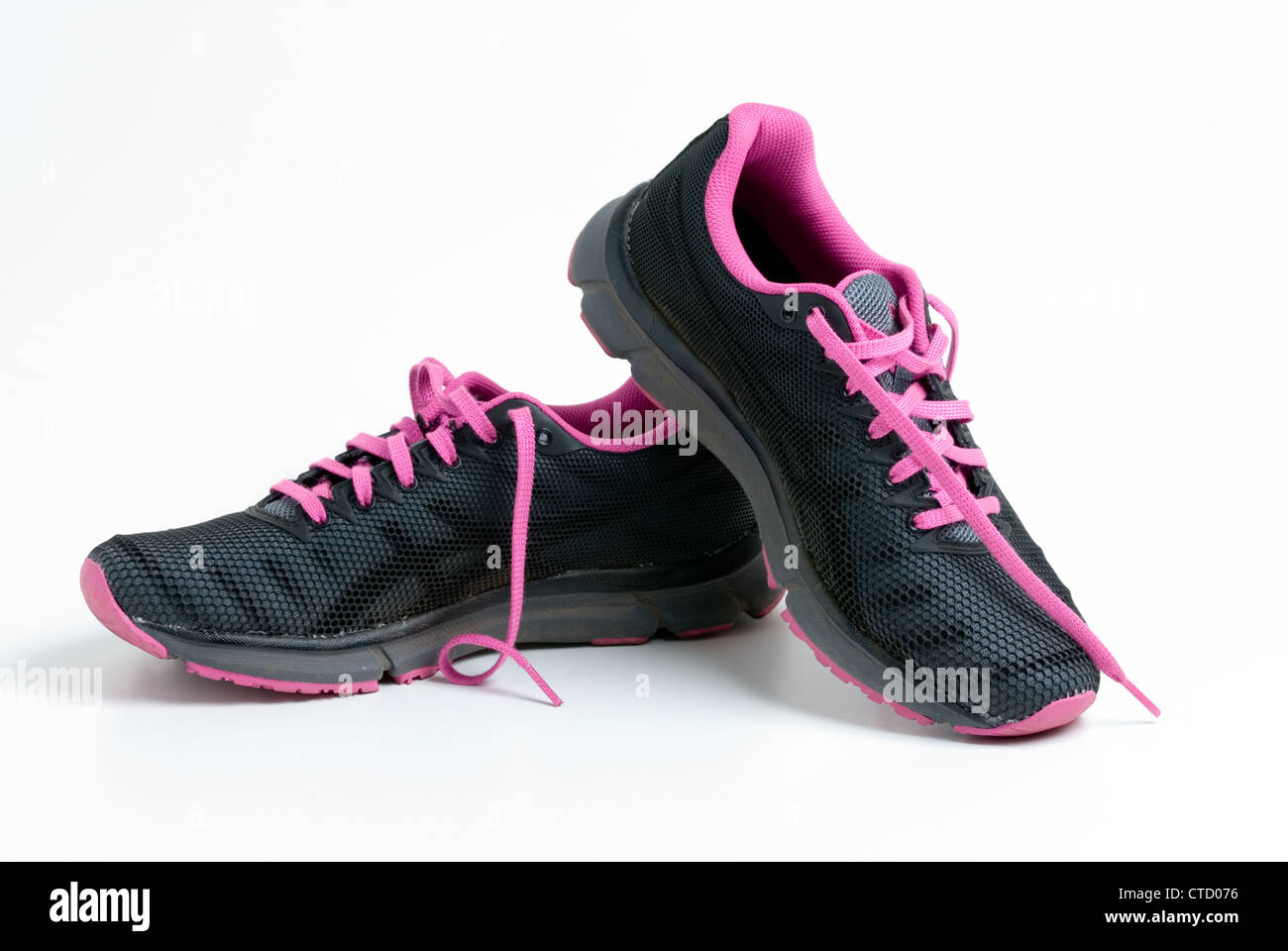 4468a3307e5e2 Worn Pair of Pink and black Asics running shoes Stock Photo ...