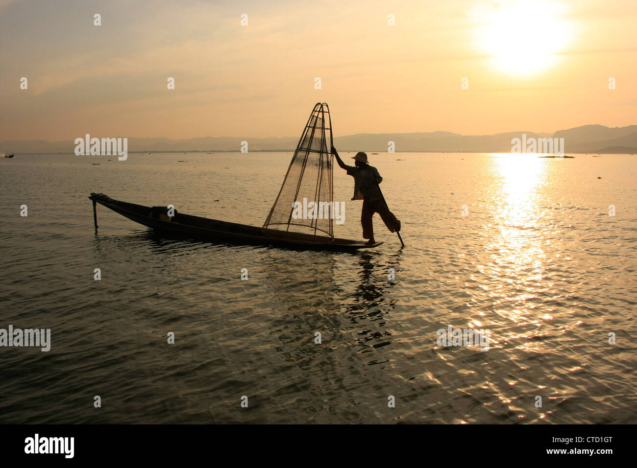 Inle lake fisherman at sunset, Shan state, Myanmar, Southeast Asia - Stock Image