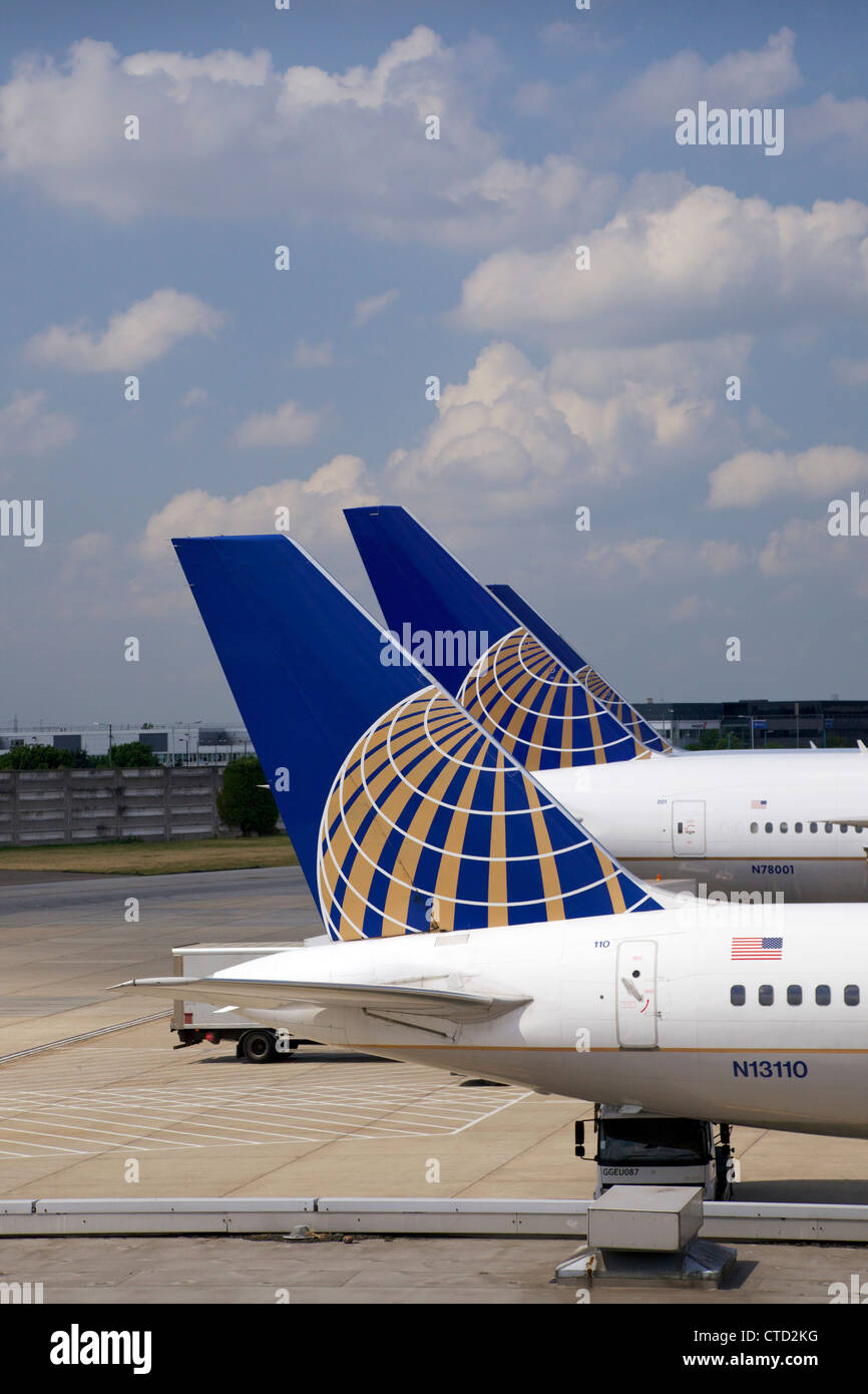 Continental airlines passenger jet tailfins at Terminal 4, Heathrow Airport, London, England, UK, United Kingdom, - Stock Image