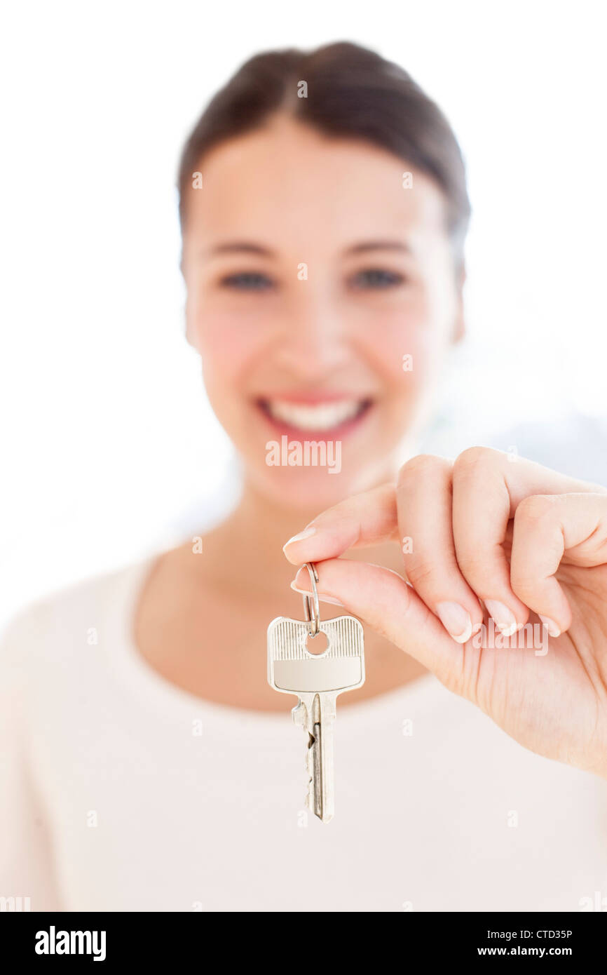 Happy woman with a key - Stock Image