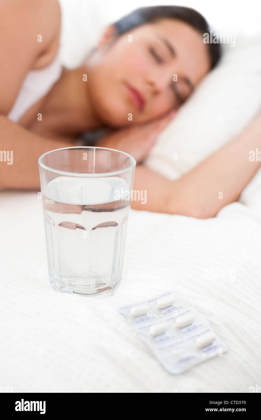 Ill woman sleeping - Stock Image