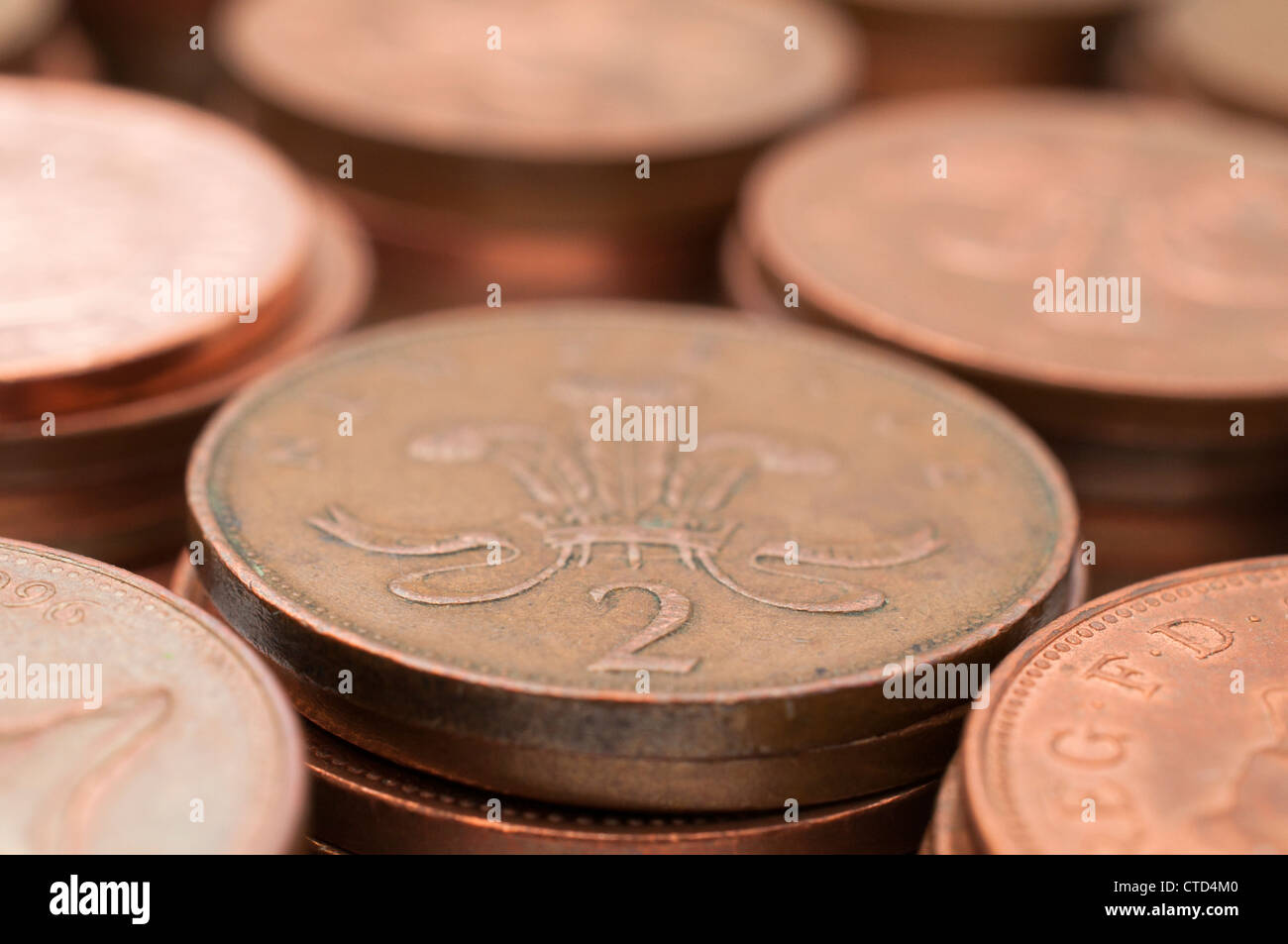 Copper two pence pieces in a pile, UK coins £ sterling - Stock Image