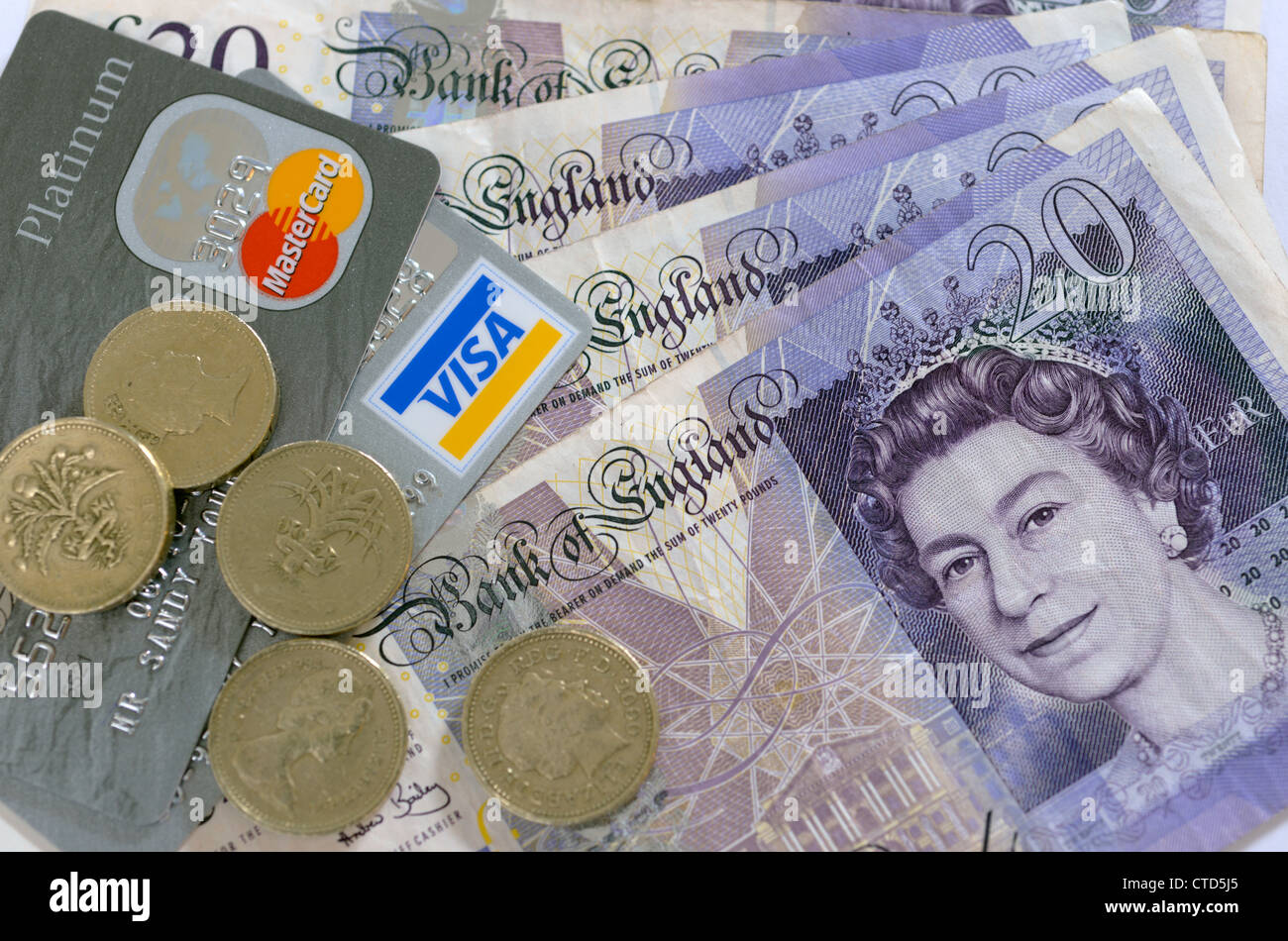 20 pound notes and one pound coins with credit card - Stock Image