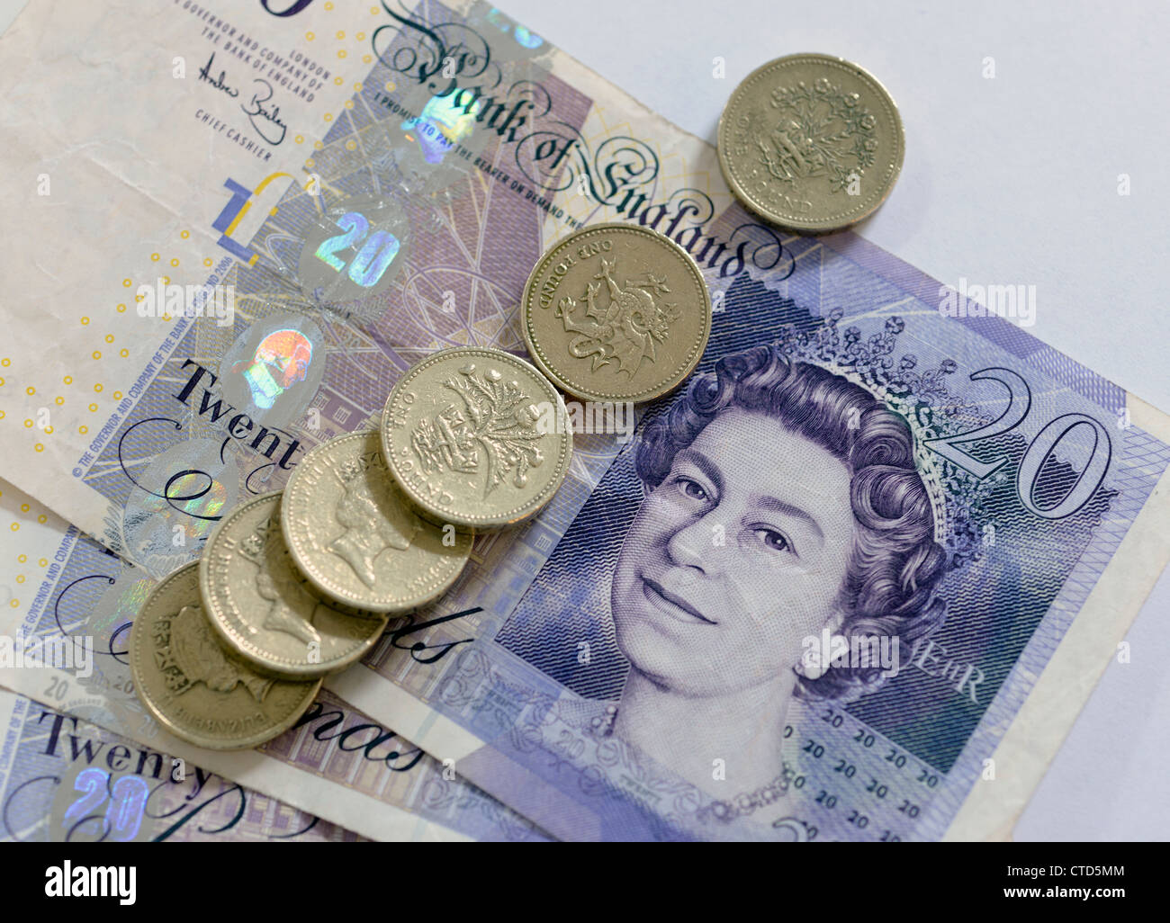 20 pound notes and one pound coins - Stock Image