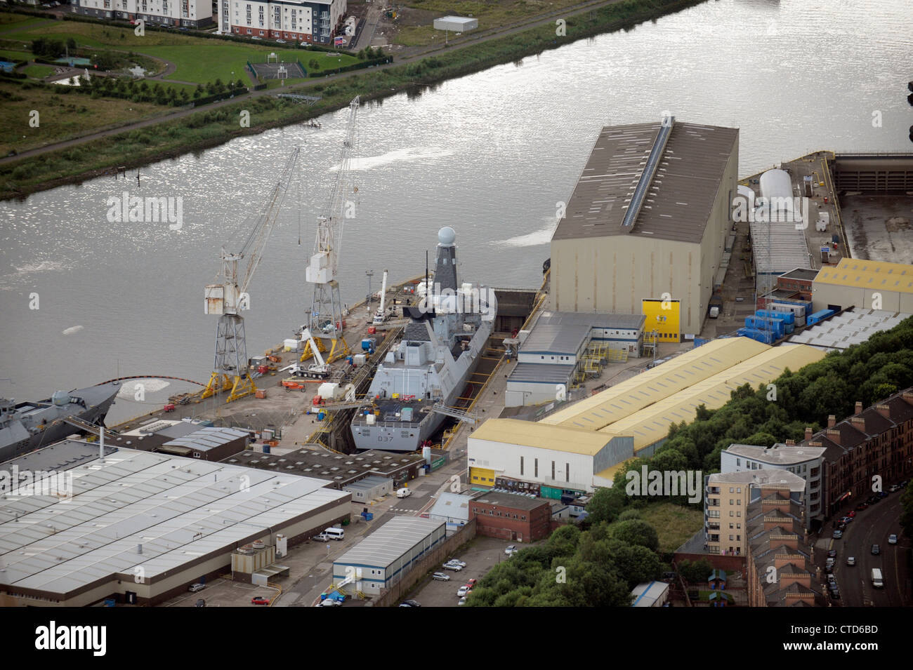 BAE Systems, Glasgow on the River Clyde, with warship in dock. - Stock Image