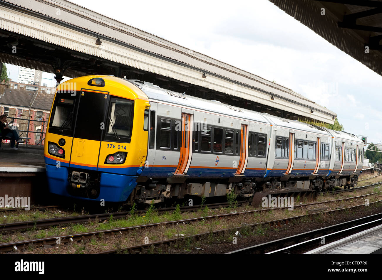Class 378 passenger train in London Overground livery at Clapham Junction, England. - Stock Image