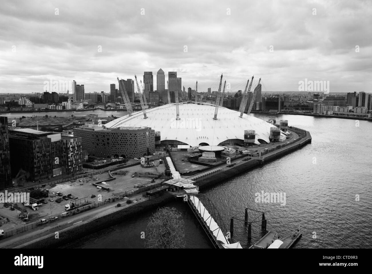 Aerial of O2 Arena on Greenwich Peninsula with Canary Wharf in background, London UK - Stock Image