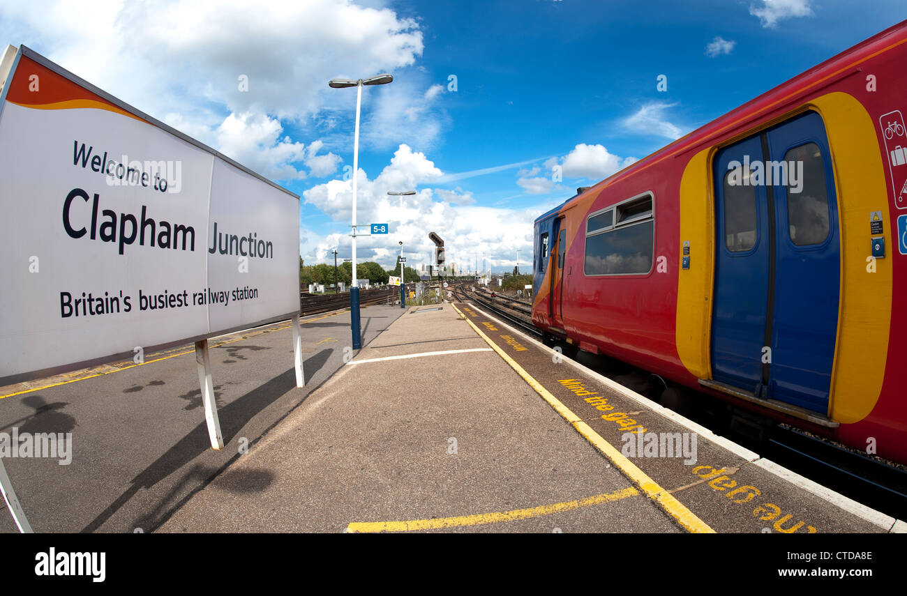 Welcome sign on the platform of Clapham Junction and train in South West Trains livery, England. - Stock Image
