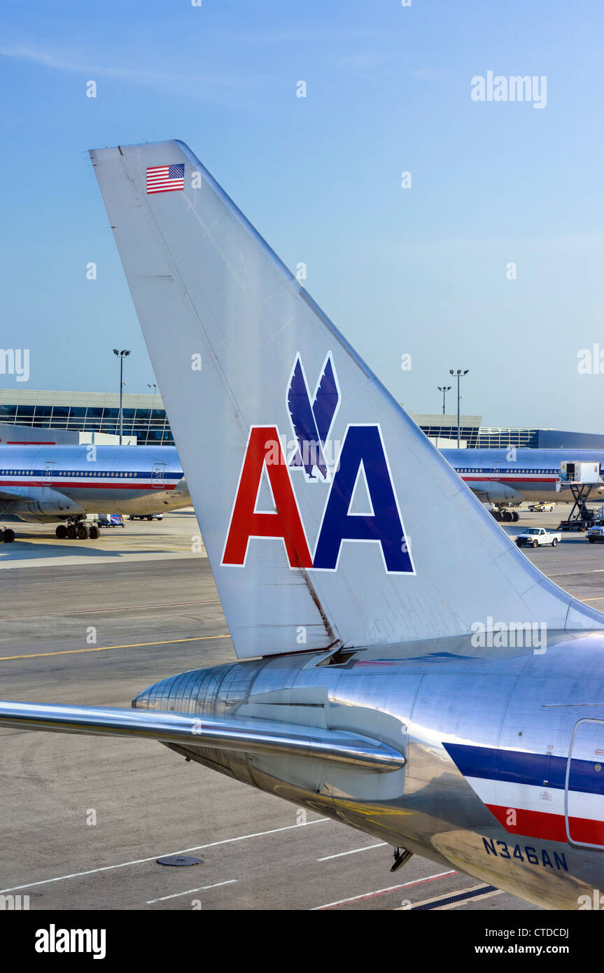 The tail of an American Airlines Boeing 767-300 aircraft parked at the gate at JFK Airport, New York, USA - Stock Image