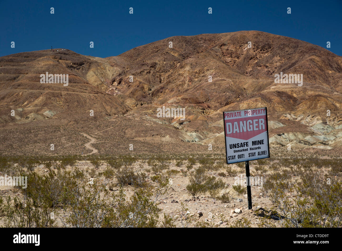 Barstow, California - A sign warns visitors to stay away from unsafe mines in the Mojave Desert. - Stock Image