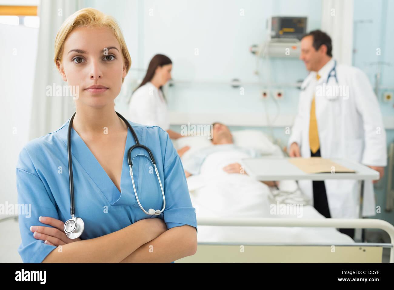 blonde nurse next to medical bed stock photo 49468819 alamy