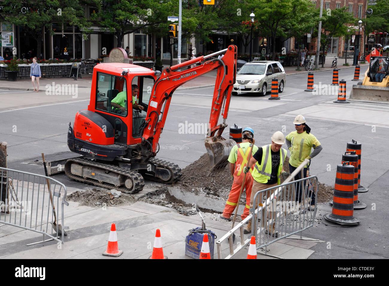 Road Crew Repairing A Street In Toronto Canada - Stock Image