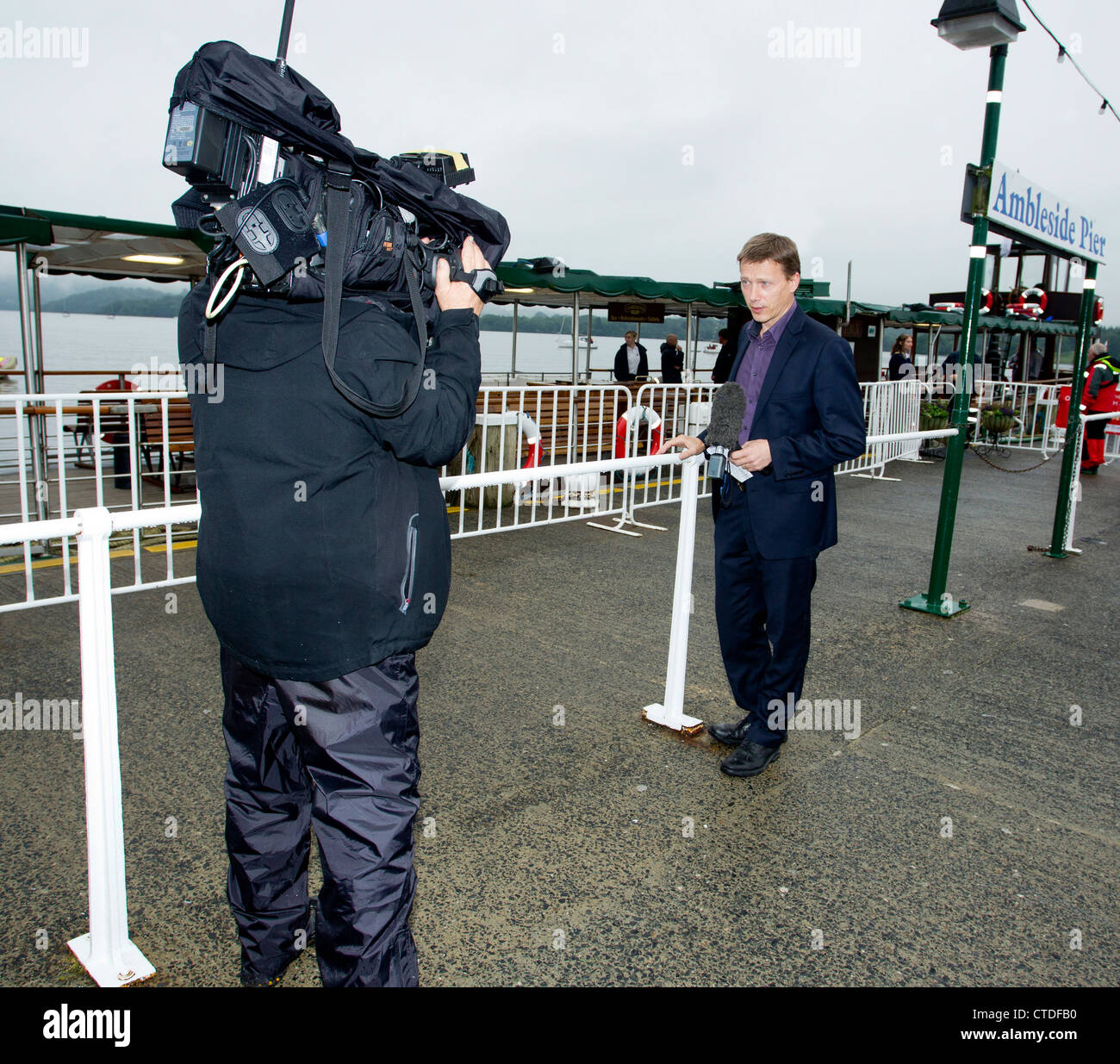 Peter Marshall is a reporter presenter on BBC regional North West Tonight.on location live broadcast from Ambleside - Stock Image