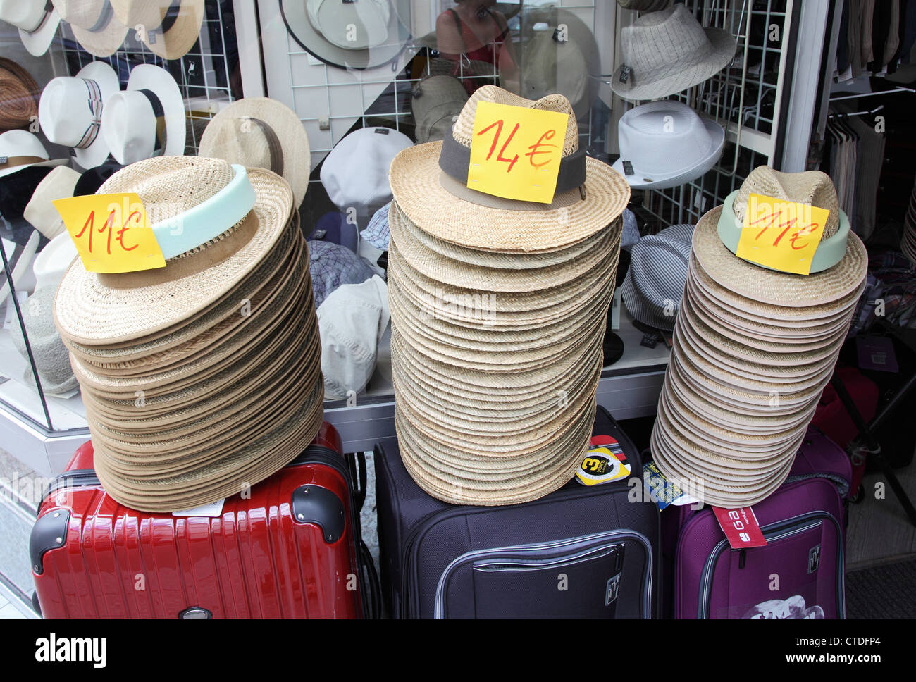 Stacks of straw panama hats or boaters within a shop in France - Stock Image