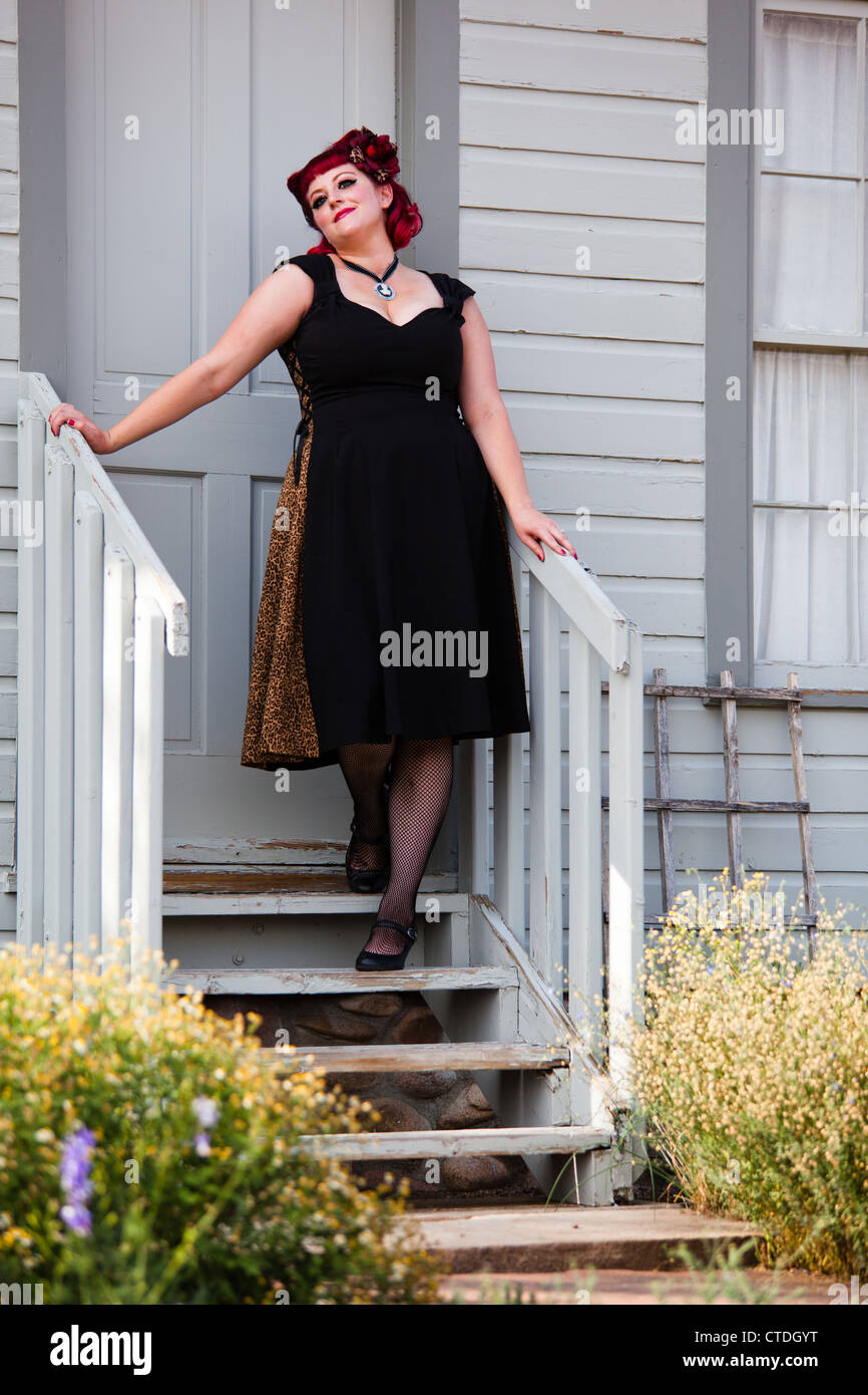 1e661161a4c 1950 s style pinup model posing as a housewife - Stock Image
