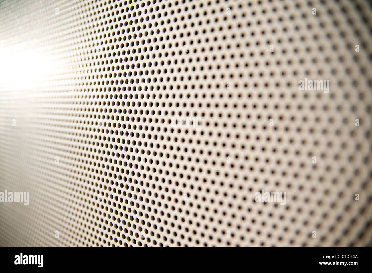close up of perforated pattern with selective focus - Stock Image