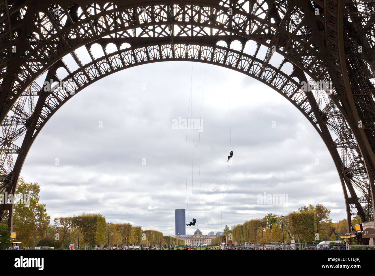 Paris, France: Paris firemen practice their skills from a base arch of the Eiffel Tower. Stock Photo