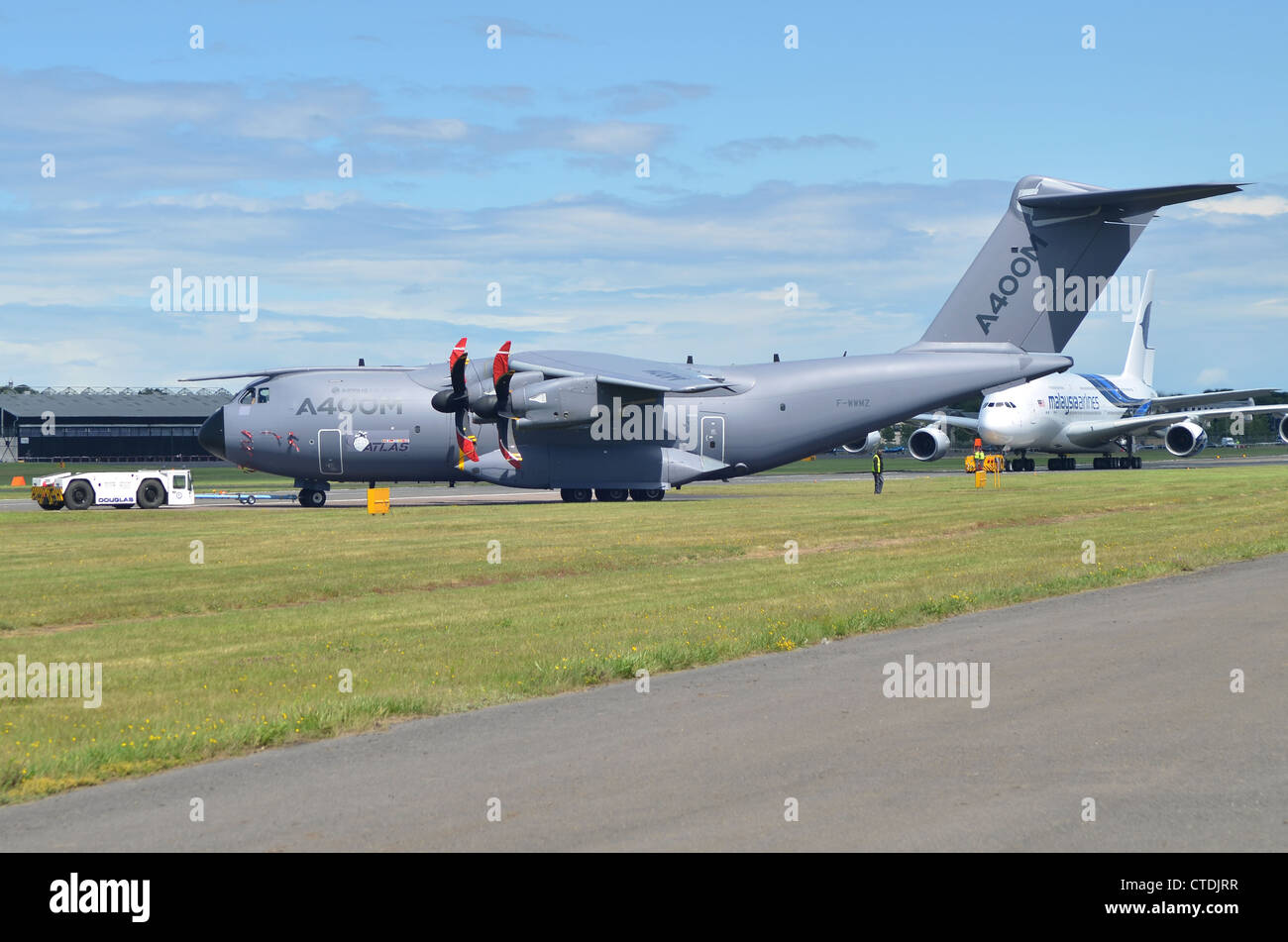Airbus Military A400M being pushed back at Farnborough International Airshow, 2012. - Stock Image