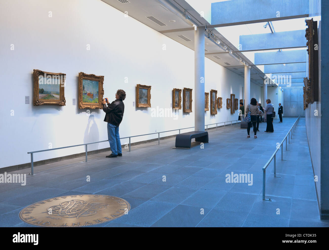 Paris, France: Person taking picture of fine art in the Musee de l'Orangerie. Editorial use only. - Stock Image
