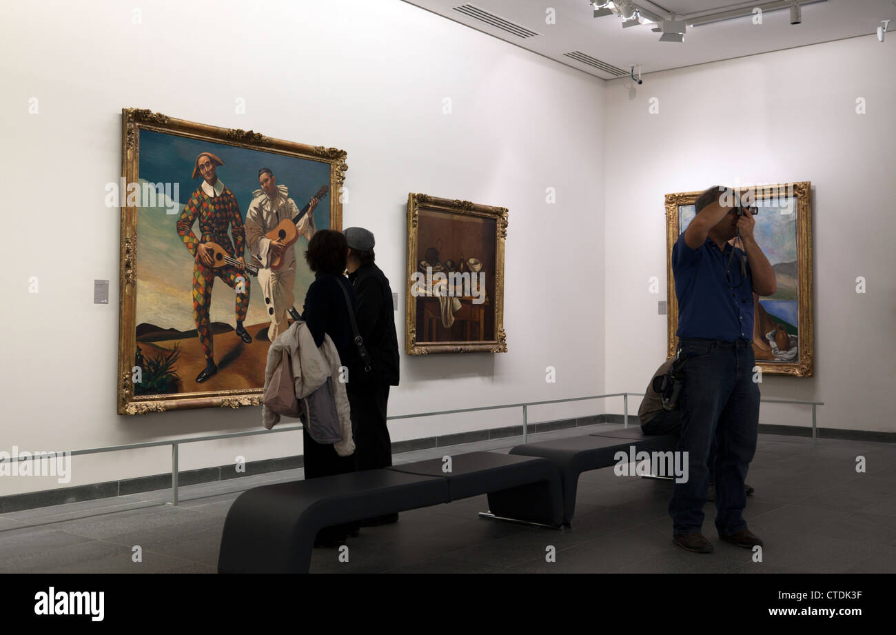 People looking at paintings at the Musee de l'Orangerie in Paris. - Stock Image